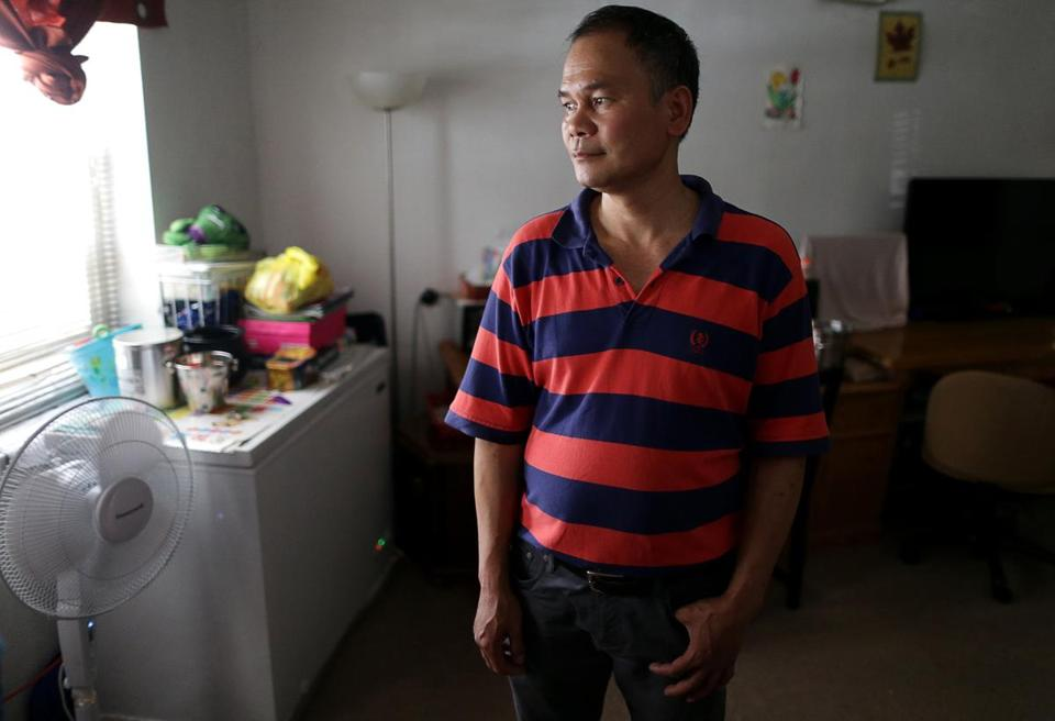 07/12/2017 Boston Ma- Zhenyou Mo (cq) lives at 410-412 Harrison Avenue . The building is being sold to make way for new development. The current residents will have to move. He is photographed inside his first floor apartment. Jonathan Wiggs\Globe Staff Reporter:Topic.