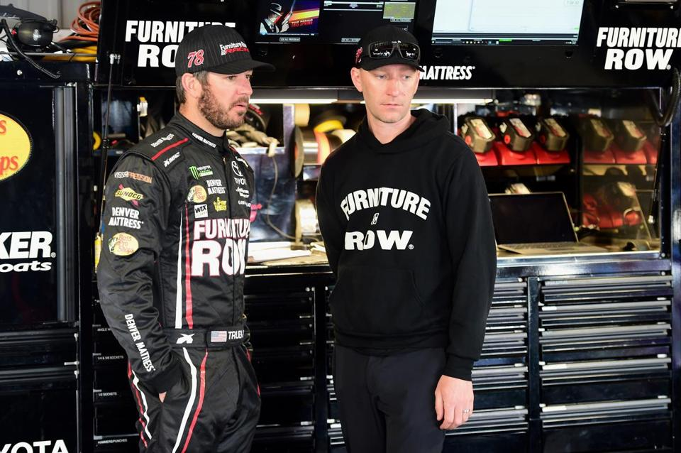 MARTINSVILLE, VA - APRIL 01: Martin Truex Jr., driver of the #78 Furniture Row/Denver Mattress Toyota, stands in the garage with his crew chief Cole Pearn during practice for the Monster Energy NASCAR Cup Series STP 500 at Martinsville Speedway on April 1, 2017 in Martinsville, Virginia. (Photo by Jared C. Tilton/Getty Images)