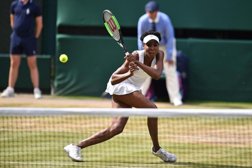 US player Venus Williams returns against Britain's Johanna Konta during their women's singles semi-final match on the tenth day of the 2017 Wimbledon Championships at The All England Lawn Tennis Club in Wimbledon, southwest London, on July 13, 2017. / AFP PHOTO / Glyn KIRK / RESTRICTED TO EDITORIAL USEGLYN KIRK/AFP/Getty Images