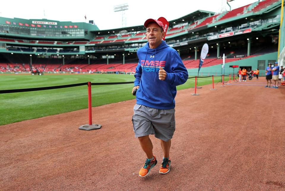 Boston-07/15/2017-Dave McGillivray runs along the warning track of Fenway Park as he checked out the course for a September 15th 2017 marathon fundraiser to be held inside the ballpark. It will be the first time a marathon will be held inside a major league ball field. He has dozens of runners already signed up for the event. John Tlumacki/Globe Staff(sports)