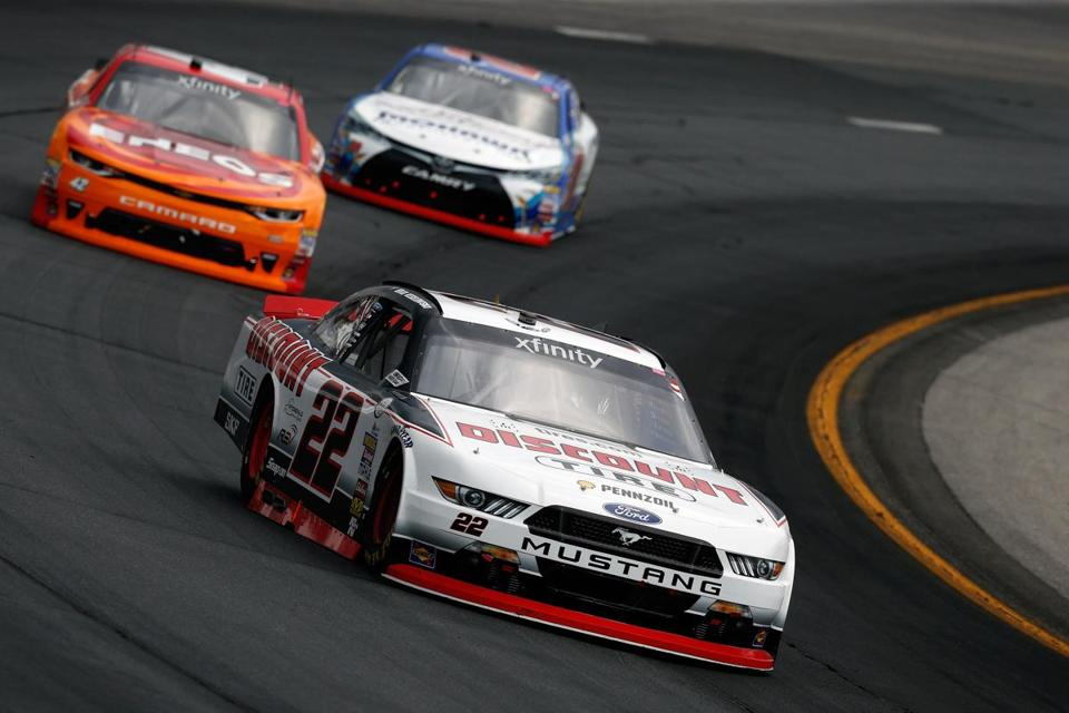 LOUDON, NH - JULY 15: Brad Keselowski, driver of the #22 Discount Tire Ford, leads Kyle Larson, driver of the #42 ENEOS Chevrolet, and Ryan Preece, driver of the #20 MoHawk Northeast Inc. Toyota, during the NASCAR XFINITY Series Overton's 200 at New Hampshire Motor Speedway on July 15, 2017 in Loudon, New Hampshire. (Photo by Jeff Zelevansky/Getty Images)