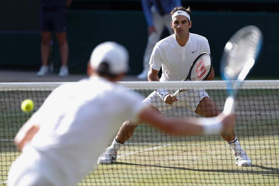 TOPSHOT - Switzerland's Roger Federer (R) returns against Czech Republic's Tomas Berdych during their men's singles semi-final match on the eleventh day of the 2017 Wimbledon Championships at The All England Lawn Tennis Club in Wimbledon, southwest London, on July 14, 2017. / AFP PHOTO / Adrian DENNIS / RESTRICTED TO EDITORIAL USEADRIAN DENNIS/AFP/Getty Images