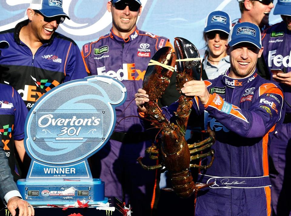 LOUDON, NH - JULY 16: Denny Hamlin, driver of the #11 FedEx Office Toyota, poses with a lobster in Victory Lane after winning the Monster Energy NASCAR Cup Series Overton's 301 at New Hampshire Motor Speedway on July 16, 2017 in Loudon, New Hampshire. (Photo by Jeff Zelevansky/Getty Images)