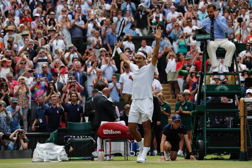 Switzerland's Roger Federer celebrates after winning against Croatia's Marin Cilic during their men's singles final match on the last day of the 2017 Wimbledon Championships at The All England Lawn Tennis Club in Wimbledon, southwest London, on July 16, 2017. Roger Federer won 6-3, 6-1, 6-4. / AFP PHOTO / Adrian DENNIS / RESTRICTED TO EDITORIAL USEADRIAN DENNIS/AFP/Getty Images