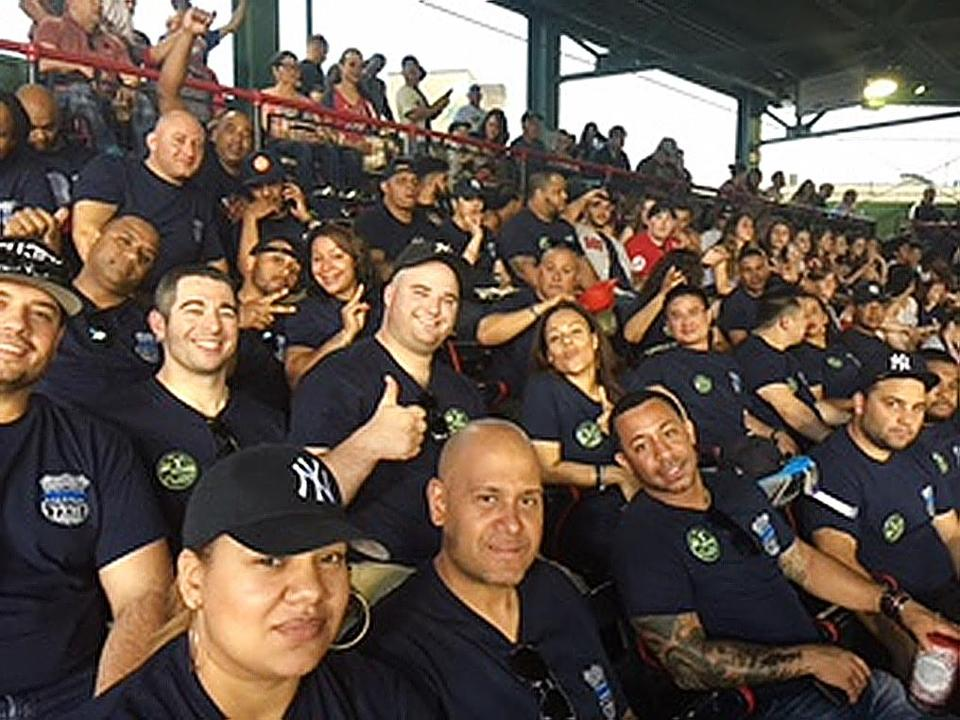 NYPD officers, wearing T-shirts that honored their murdered colleague Officer Miosotis Familia, attended Sunday night's Red Sox-Yankees game at Fenway Park.
