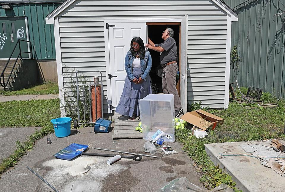 Camille Clark, deputy director of the Sportsmen's Tennis and Enrichment Center, and Carlos Telles, the finance director, examined the damage.