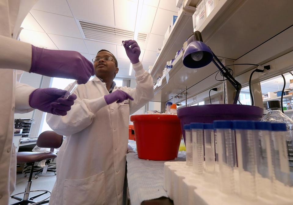 A scientist in a lab at Vertex Pharmaceuticals Inc.