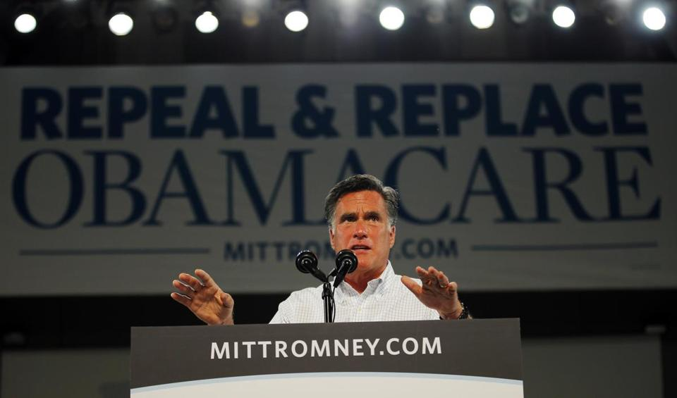 "Republican presidential nominee Mitt Romney speaks under a banner that reads ""Repeal and Replace Obamacare"" at a campaign rally in Apopka, Florida October 6, 2012. REUTERS/Brian Snyder (UNITED STATES - Tags: POLITICS ELECTIONS USA PRESIDENTIAL ELECTION)"