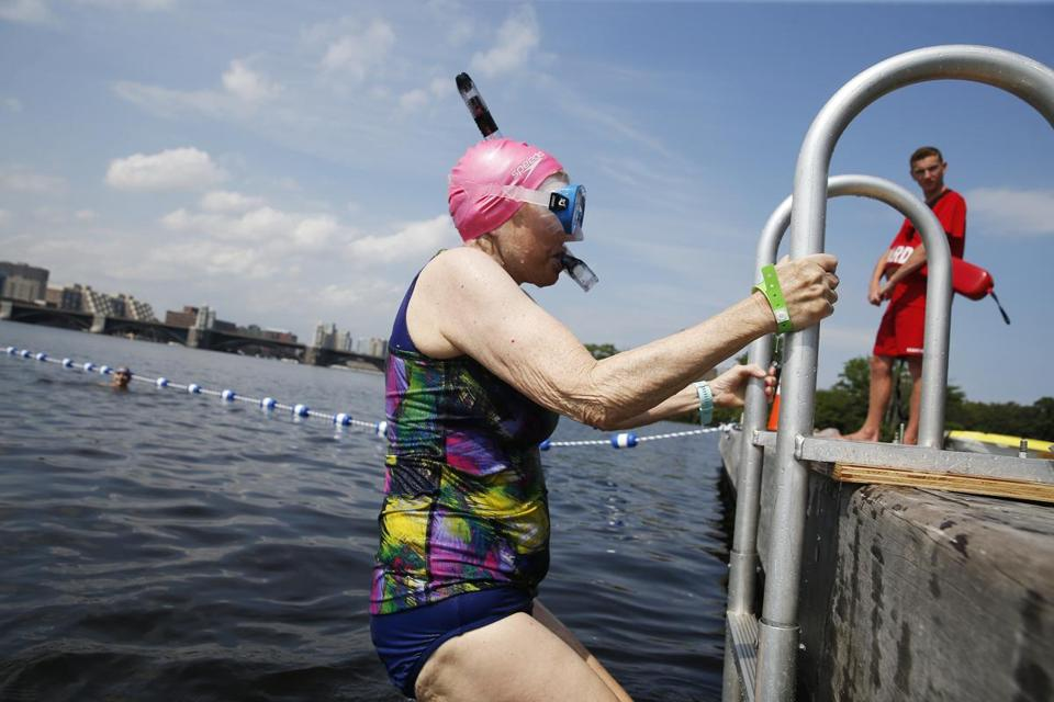 Barbara Evans of Lakeville climbed out of the water Tuesday after a sanctioned swimming event in the Charles.