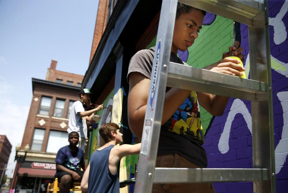 Elijah Fernandes, right, worked with others on public art projects in Lynn.