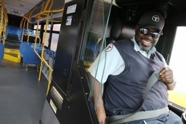 Bus driver Daron Banks tried out a new compressed-natural-gas bus being displayed by the MBTA in Bostonon Tuesday.
