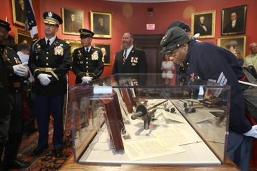 First Sergeant Gerard Grimes looked at the sword of Union Colonel Robert Gould Shaw after it was unveiled on Tuesday at the Massachusetts Historical Society. Grimes is a member of the he 54th Massachusetts Volunteer Infantry Regiment, Company A, a National Guard ceremonial unit.