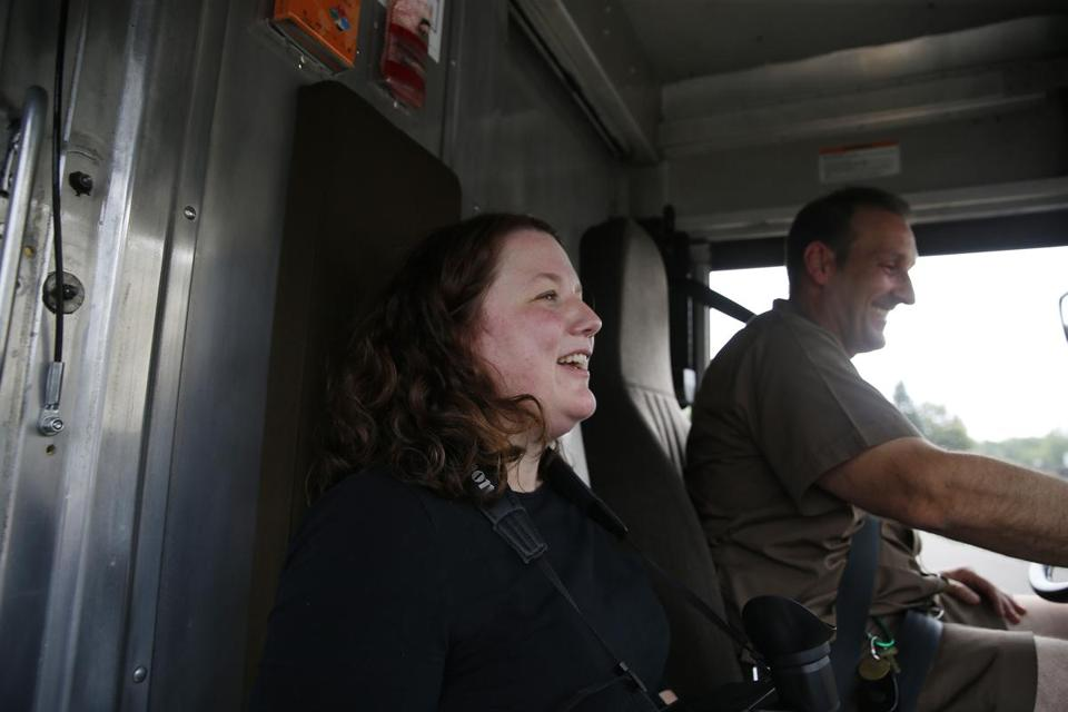 West Boylston, MA -- 7/20/2017 - Globe Magazine reporter Stacey Myers (L) laughs as Tracy Marks, a Corporate Facilitator for UPS, gives a running commentary of everything he's seeing on the road as he runs through a training session for Boston Globe at UPS's driver training school. (Jessica Rinaldi/Globe Staff) Topic: 081317massdrivers Reporter: FOR MAGAZINE STORY. PLEASE DON'T USE UNTIL MAG STORY IS PUBLISHED.