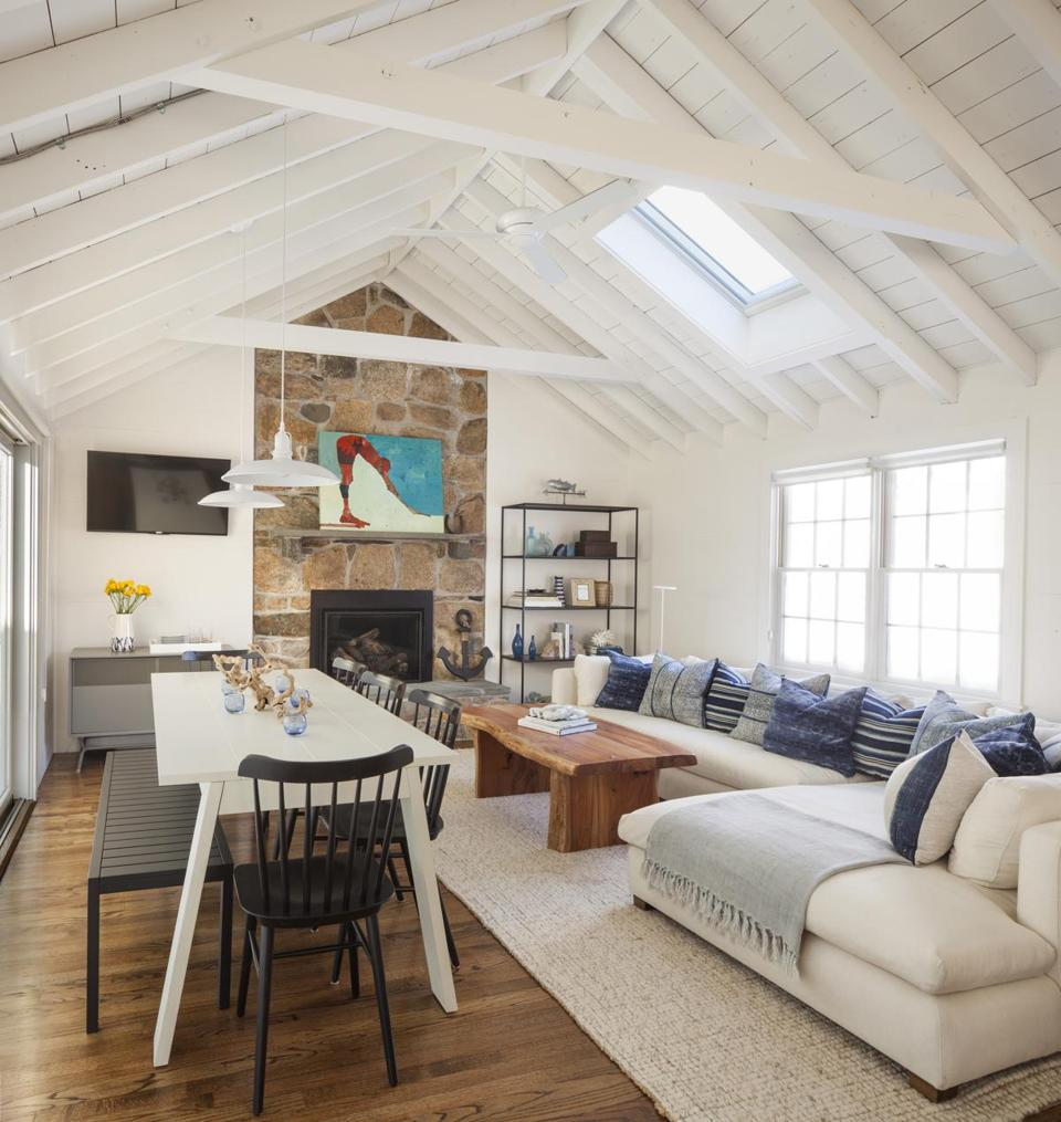 In the living/dining room, indigo blue pillows from Jayson Home and Calypso St. Barth perk up the Montauk Sofa sectional. Salt chairs from Design Within Reach have a compact footprint, and a picnic bench tucks neatly under the table when not in use. Walls and ceilings throughout are painted Benjamin Moore White Dove, a warm white that contributes to the lived-in feel.
