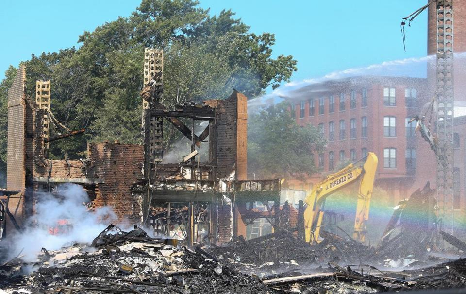 Smoldering rubble could be seen Sunday.