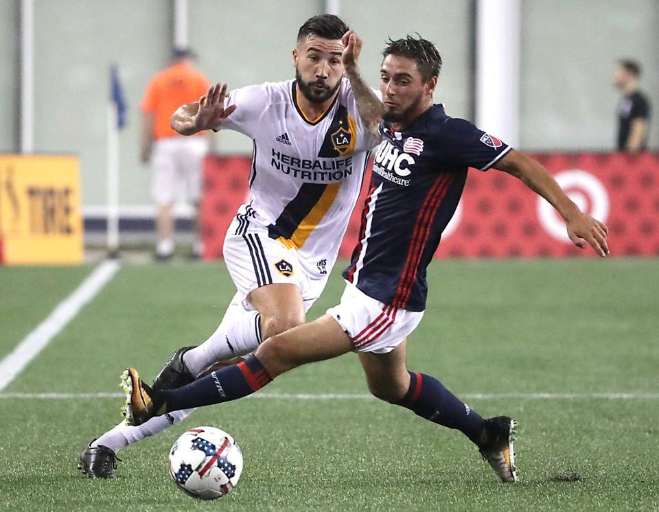 Foxborough MA 07/22/17 New England Revolution Diego Fagundez controls the ball in front of Los Angeles Galaxy Romain Allessandrini during first half MLS action at Gillette Stadium. (Matthew J. Lee/Globe staff) topic: reporter: