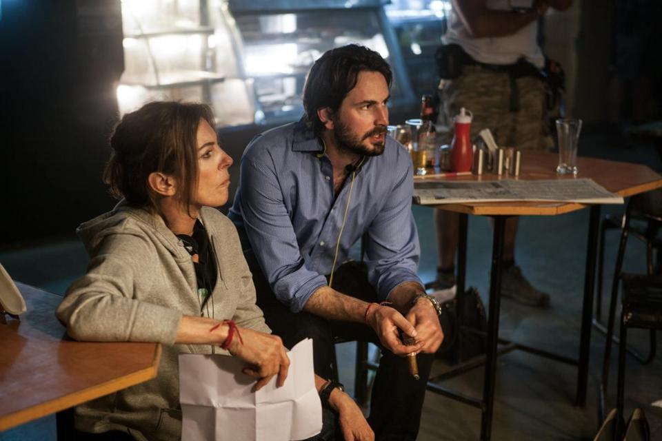 "Director Kathryn Bigelow and screenwriter Mark Boal on the set of one of their earlier collaborations, ""Zero Dark Thirty."""