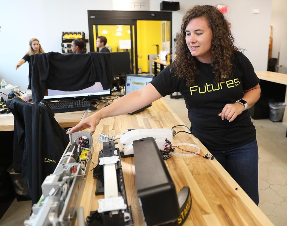 Susannah Hamblin, a product manager, demonstrated a door opener at Stanley's innovation center.