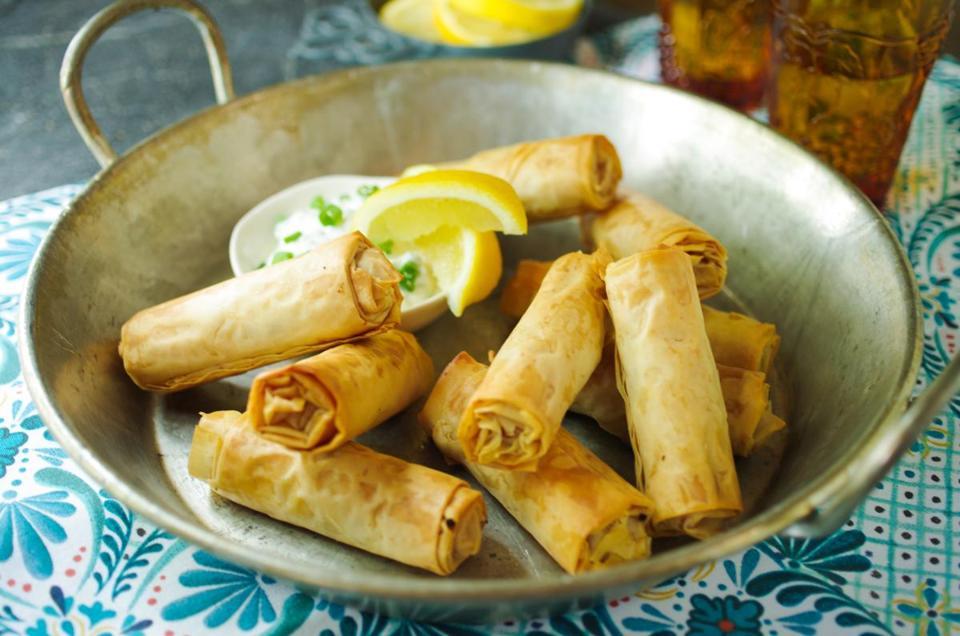 Slender, crisp phyllo rolls hold lemony shredded chicken