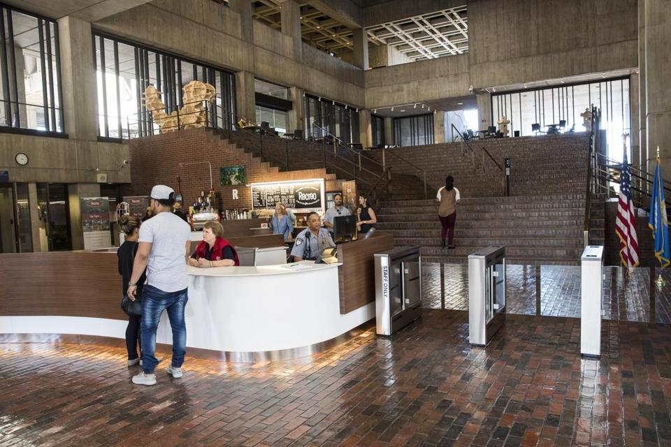 Boston, MA - 7/26/2017 - Visitors make their way through the newly renovated lobby in Boston City Hall in Boston, MA, July 26, 2017. (Keith Bedford/Globe Staff)
