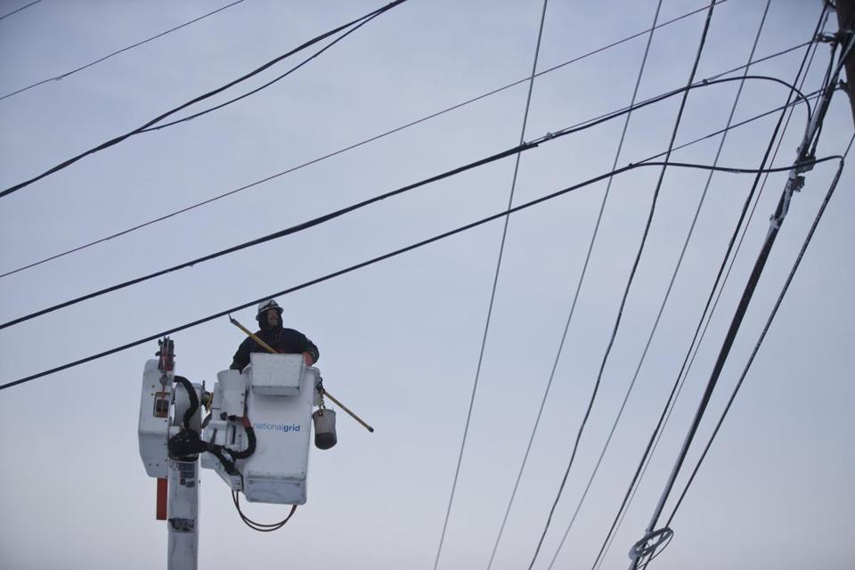 National Grid utility worker worked on a power line on Washington Steet in 2013.