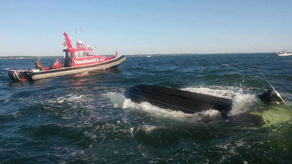 A dozen people rescued after boat overturns off Wareham.