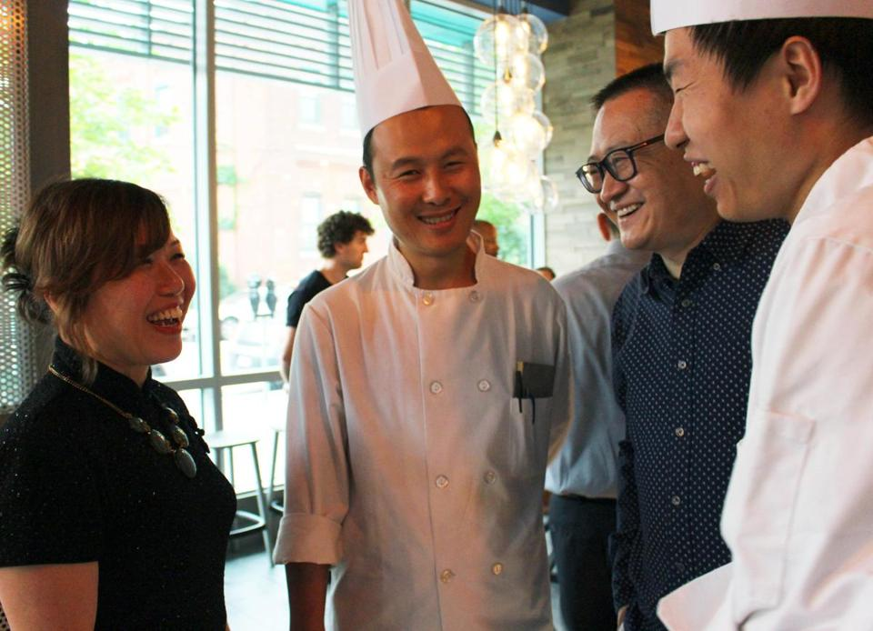 From left: Sumiao Chen, owner of Sumiao Hunan Kitchen; chef Xinke Tan; Shao Zhu, Chen's husband; and chef De Wu at the restaurant's opening on July 27.