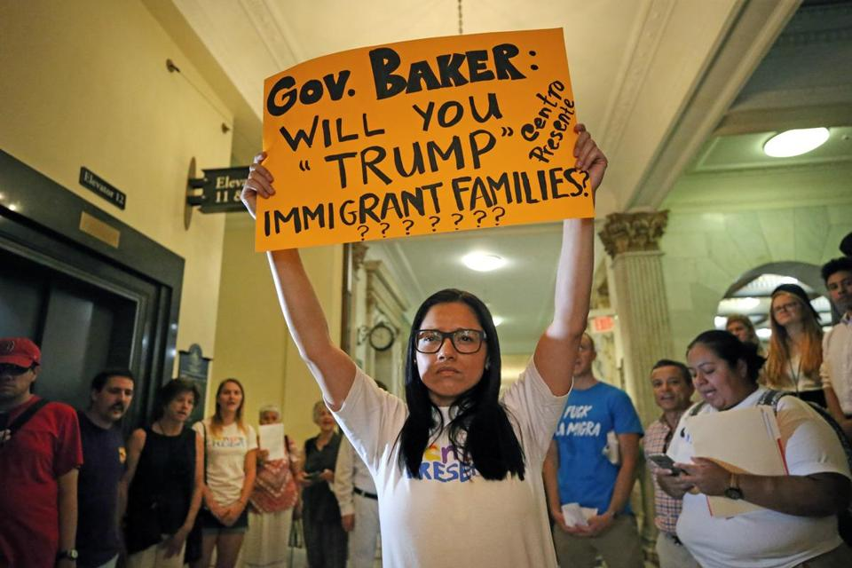 BOSTON, MA - 7/28/2017: Patricia Montes with Centro Presente which is a member-driven, state-wide Latin American immigrant organization dedicated to the self-determination and self-sufficiency of the Latin American immigrant community of Massachusetts holds up her sign in protest in front of Governor Baker's office at the Massachusetts State House. (David L Ryan/Globe Staff ) SECTION: METRO TOPIC stand alone photo