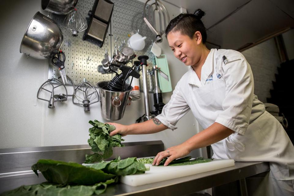 07/25/2017 BOSTON, MA Cofounder Irene Li (cq) chops collard greens to use in a pesto sauce at Mei Mei in Boston. (Aram Boghosian for The Boston Globe)