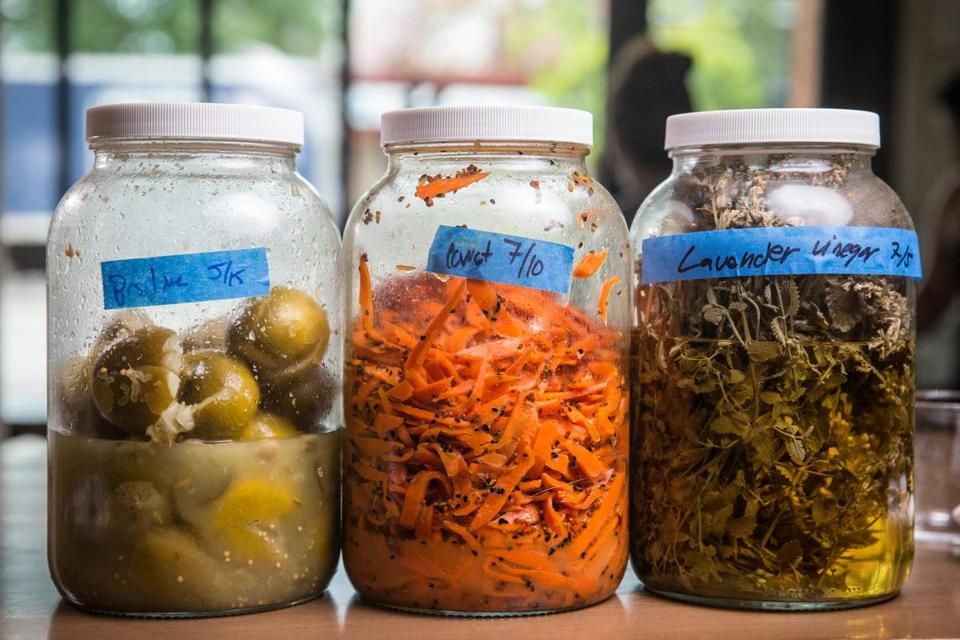 07/27/2017 CAMBRIDGE, MA L-R Indian pickled lime, carrot scraps and lavender vinegar made from leftovers at Little Donkey in Cambridge. (Aram Boghosian for The Boston Globe)