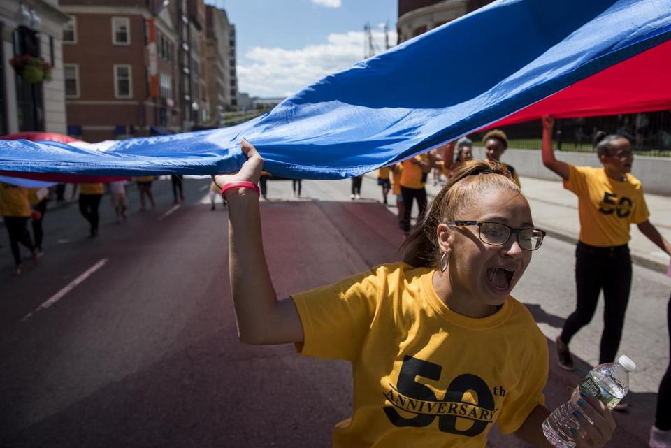 Kayleen Aponte chanted during the 50th annual Puerto Rican Festival parade, which began at the Hynes Convention Center on Sunday.