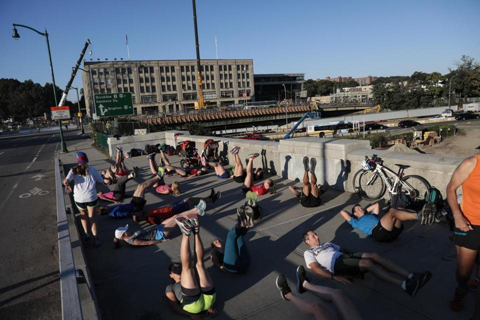 People from an exercise group worked out on the BU Bridge. The group is taking advantage of the bridge's closure.