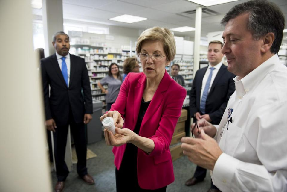 Senator Elizabeth Warren and pharmacy operations manager Donato Mazzola spoke Monday about an automatic prescription-filling machine during a tour of the East Boston Neighborhood Health Center. Patients and staff at the center thanked Warren for her efforts to uphold the Affordable Care Act.