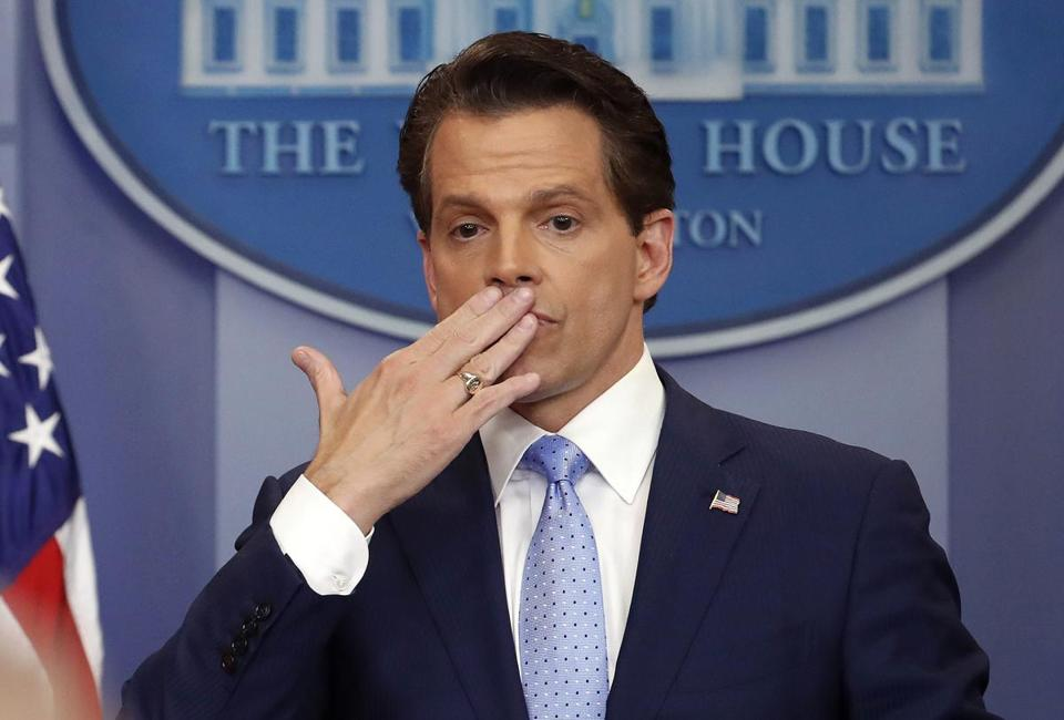 In this July 21, 2017 photo, incoming White House communications director Anthony Scaramucci, right, blowing a kiss after answering questions during the press briefing in the Brady Press Briefing room of the White House in Washington. Scaramucci is out as White House communications director after just 11 days on the job. A person close to Scaramucci confirmed the staffing change just hours after President Donald Trump's new chief of staff, John Kelly, was sworn into office. (AP Photo/Pablo Martinez Monsivais)
