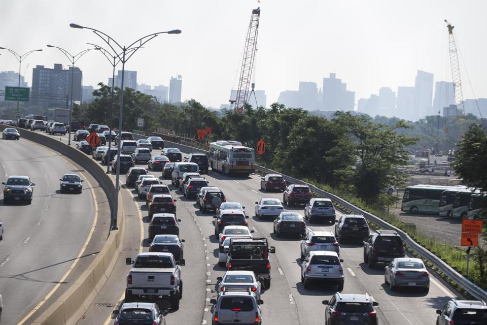 Boston, MA - 8/1/2017 - Traffic backs up along the Massachusetts Turnpike in the Allston neighborhood of Boston, MA, August 1, 2017. Interstate 90 reduces to two lanes of traffic each way through parts of Boston while workers rebuild the Commonwealth Avenue Bridge. (Keith Bedford/Globe Staff)