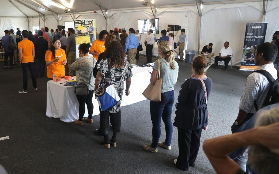 Fall River, MA - 8/2/2017 - Staffing specialist Simran Gill (cq) talks to applicants at the check-in table. Amazon holds a JobsDay at its fulfillment center in Fall River. The warehouse is one of more than 70 fulfillment centers around the country. Photo by Pat Greenhouse/Globe Staff Topic: retailjobsAmazon Reporter: Katie Johnston