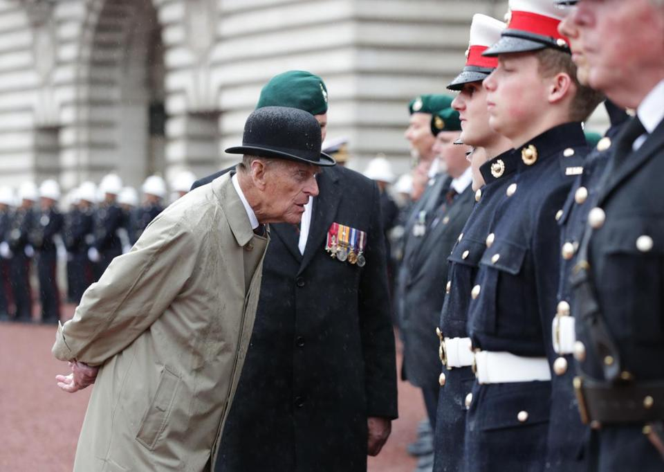 Britain's Prince Philip, Duke of Edinburgh, in his role as Captain General, Royal Marines, attends a Parade to mark the finale of the 1664 Global Challenge on the Buckingham Palace Forecourt in central London on August 2, 2017. Prince Philip, the 96-year-old husband of Queen Elizabeth II, conducted his final solo public engagement on August 2, 2017, overseeing a military parade in the pouring rain before retiring from a lifetime of service. The Duke of Edinburgh, wearing a raincoat and bowler hat, met members of the Royal Marines and veterans -- many younger than him -- before taking the salute in the forecourt of Buckingham Palace. / AFP PHOTO / POOL / Yui MokYUI MOK/AFP/Getty Images