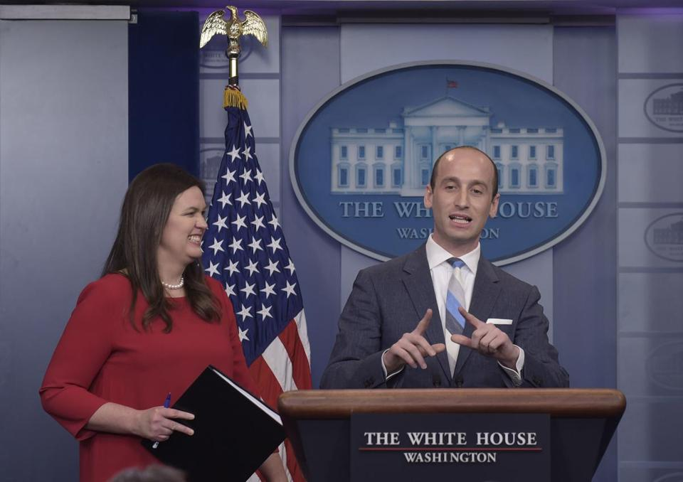 White House press secretary Sarah Huckabee Sanders, left, stands with White House senior policy adviser Stephen Miller during the daily briefing at the White House in Washington, Wednesday, Aug. 2, 2017. (AP Photo/Susan Walsh)