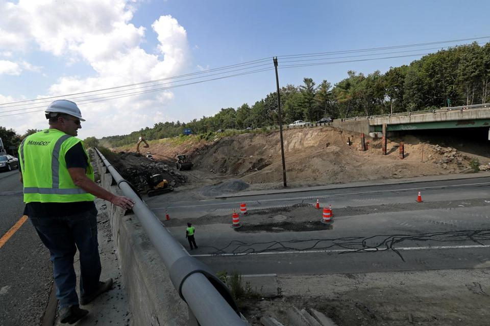 Hanover, MA - 8/01/2017 - Manny Aguiar, Resident Engineer, Mass DOT atop the southbound bridge over Webster street in Hanover that will be replaced along with the northbound bridge at right. A new median road will be constructed between the two roads. The State Department of Transportation is undertaking a $30 million project to replace four structurally deficient bridges that carry Route 3 over High Street in Norwell and over Route 123 (Webster Street) in Hanover. - (Barry Chin/Globe Staff), Section: Regional/South Week, Reporter: John Laidler, Topic: 13soroadwork, LOID: 8.3.3256216822.