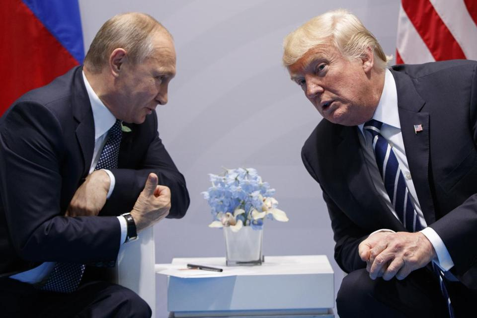 "FILE - In this July 7, 2017, file photo, President Donald Trump meets with Russian President Vladimir Putin at the G-20 Summit in Hamburg. Trump signed on Aug. 2, what he called a ""seriously flawed"" bill imposing new sanctions on Russia, pressured by his Republican Party not to move on his own toward a warmer relationship with Moscow in light of Russian actions. (AP Photo/Evan Vucci, File)"