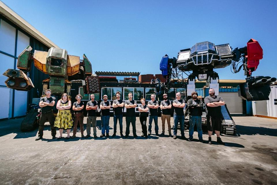 05megabots - Two Megabots along with crew. (Handout)
