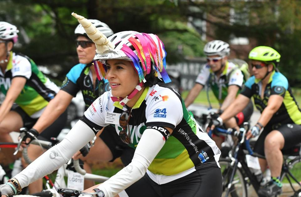 Sonya Marquez of Newton wears unicorn headgear as she and fellow participants in the Pan Mass Challenge bicycle ride, leave Babson college on the start of a two day ride, part of an effort by more than 6,200 cyclists to raise money for charity. Wellesley. Josh Reynolds for The Boston Globe (Metro, Desk )