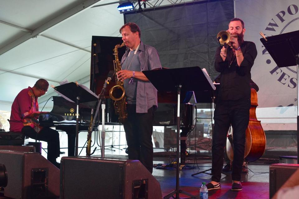 "From left: Danilo Pérez, Chris Potter, and Avishai Cohen play during the ""Jazz 100"" tribute to the centenaries of Dizzy Gillespie, Thelonious Monk, and Mongo Santamaria at the Newport Jazz Festival."