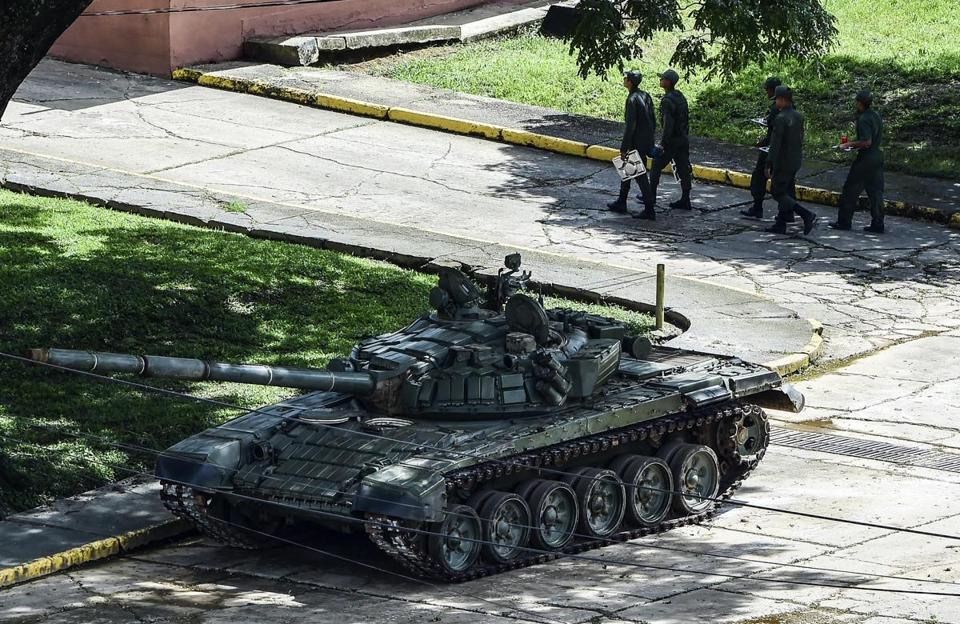 "Soldiers were seen at the Paramacay military base, in Venezuela's third city, Valencia, on Sunday, which according to officials was attacked by ""terrorists."""