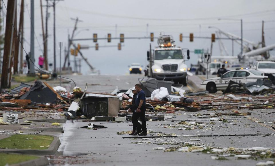 Debris from a storm covered a street in Tulsa, Okla., Sunday. About 30people were injured in what was described as an apparent tornado.