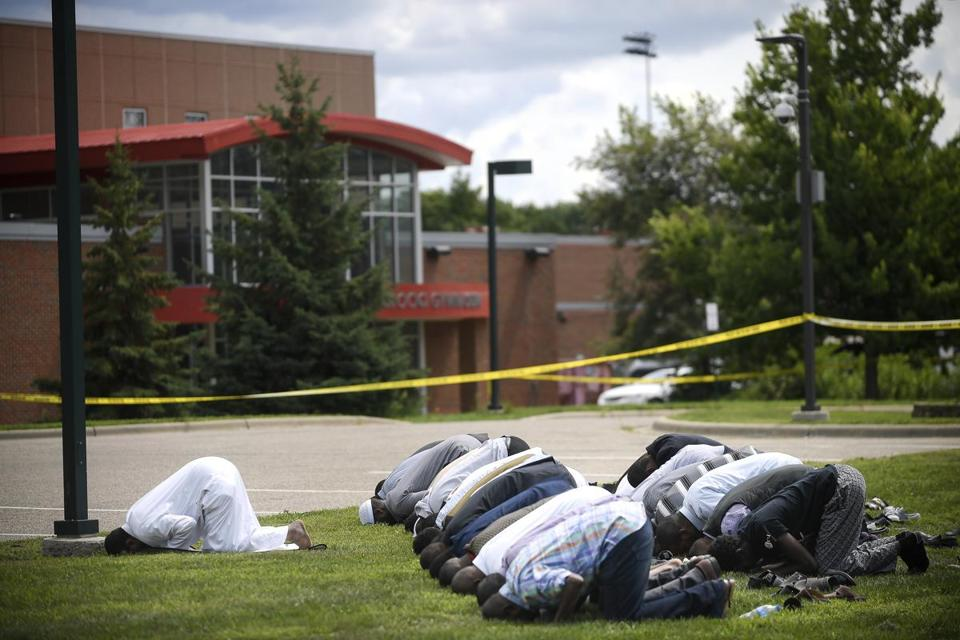 Worshipers conducted afternoon prayers Saturday outside the Dar Al-Farooq Islamic Center in Bloomington, Minn., after an explosion at the mosque.