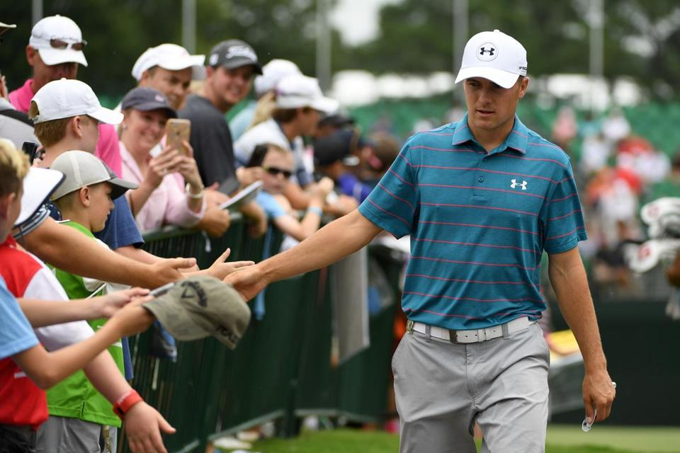 CHARLOTTE, NC - AUGUST 07: Jordan Spieth greets fans during a practice round prior to the 2017 PGA Championship at Quail Hollow Club on August 7, 2017 in Charlotte, North Carolina. (Photo by Ross Kinnaird/Getty Images)