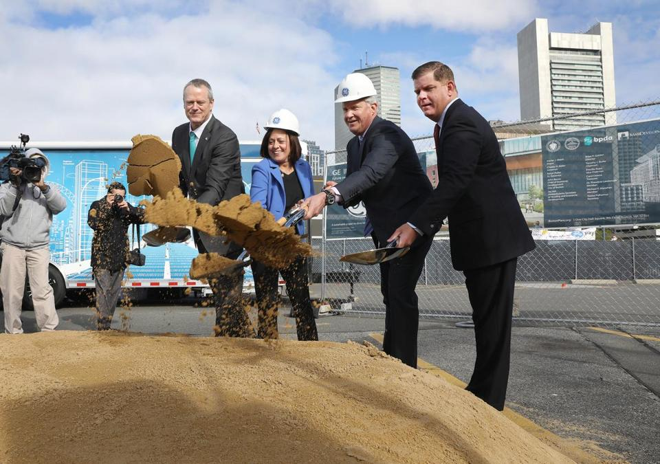 From left, Governor Charlie Baker, GE vice president Ann Klee, then-GE chief executive Jeff Immelt, and Mayor Martin J. Walsh participated at a groundbreaking for the new headquarters in Fort Point in May.