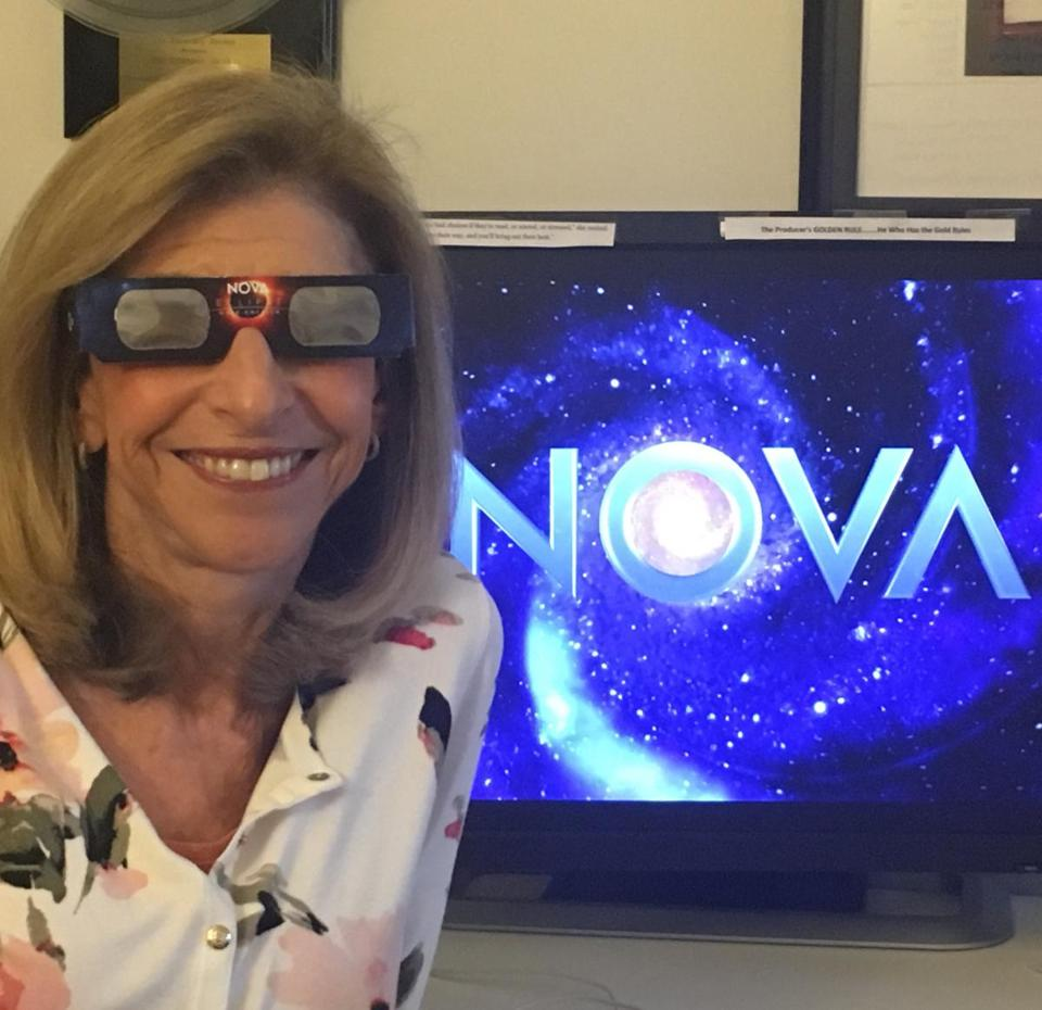 Paula S. Apsell wearing the NOVA Eclipse Over America glasses.