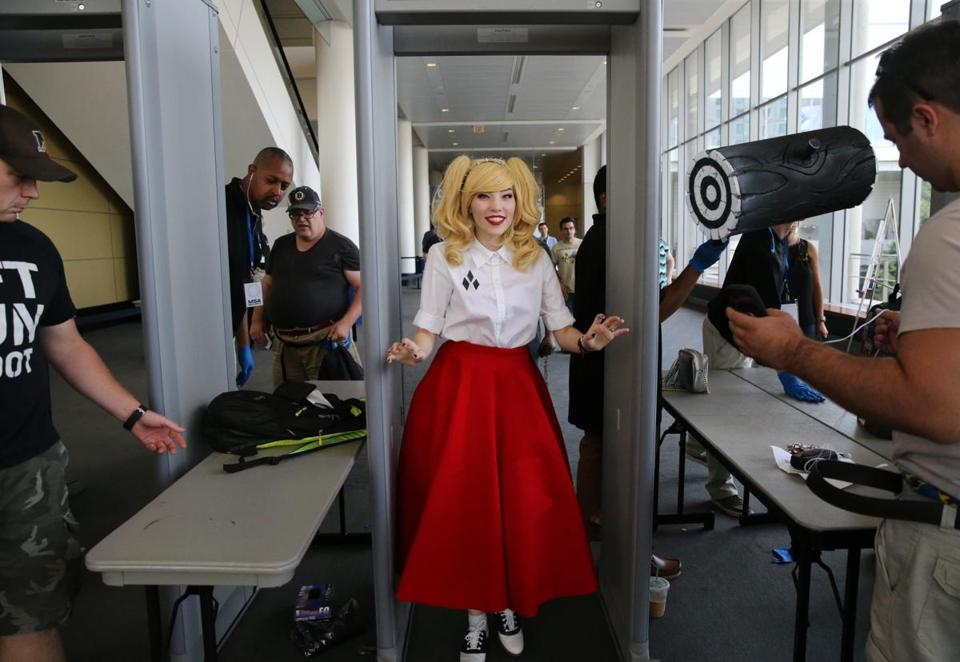 Dressed as Harley Quinn, Bethany Dornig passed through security at Boston Comic Con at the Boston Convention & Exhibition Center on Friday. More than 50,000 fans are expected to attend the event, which runs through Sunday.